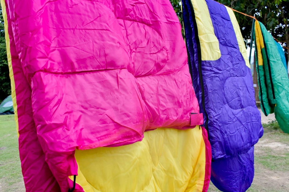 Drying sleeping bags on a clothesline.