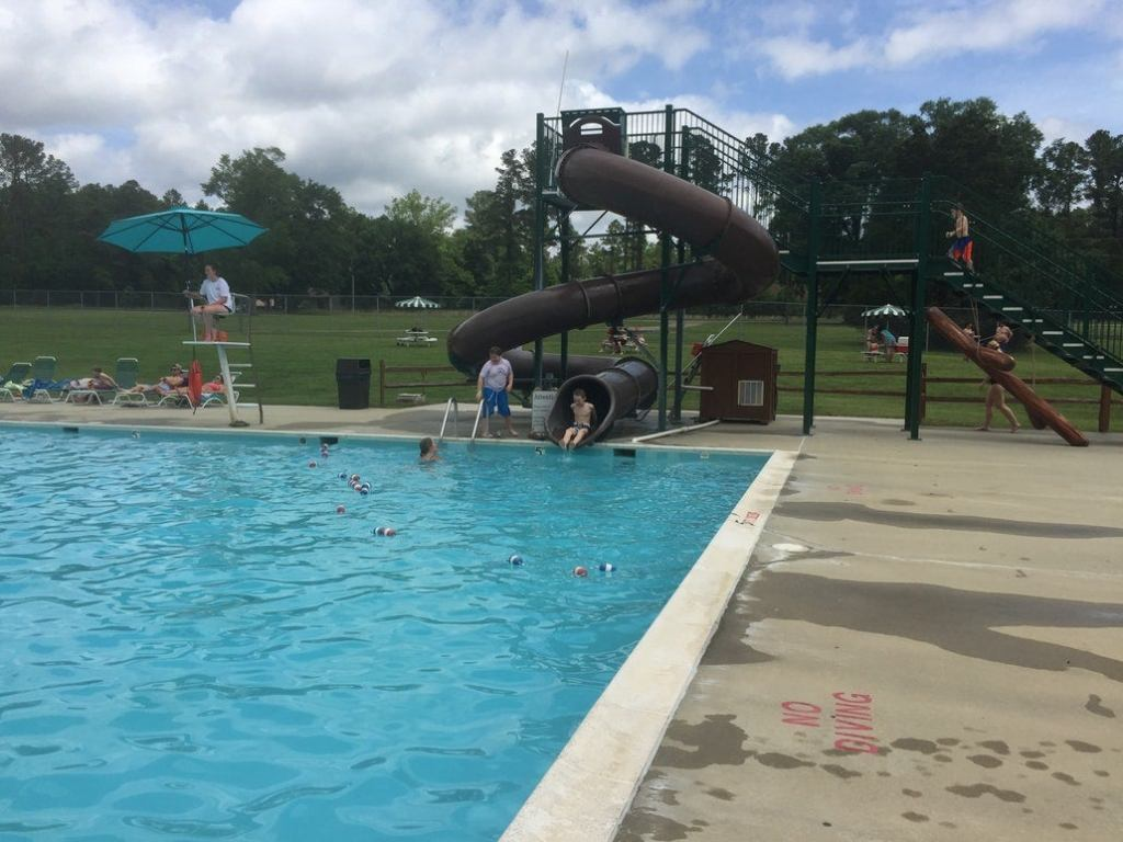 a waterslide leading to a pool in a virginia state park