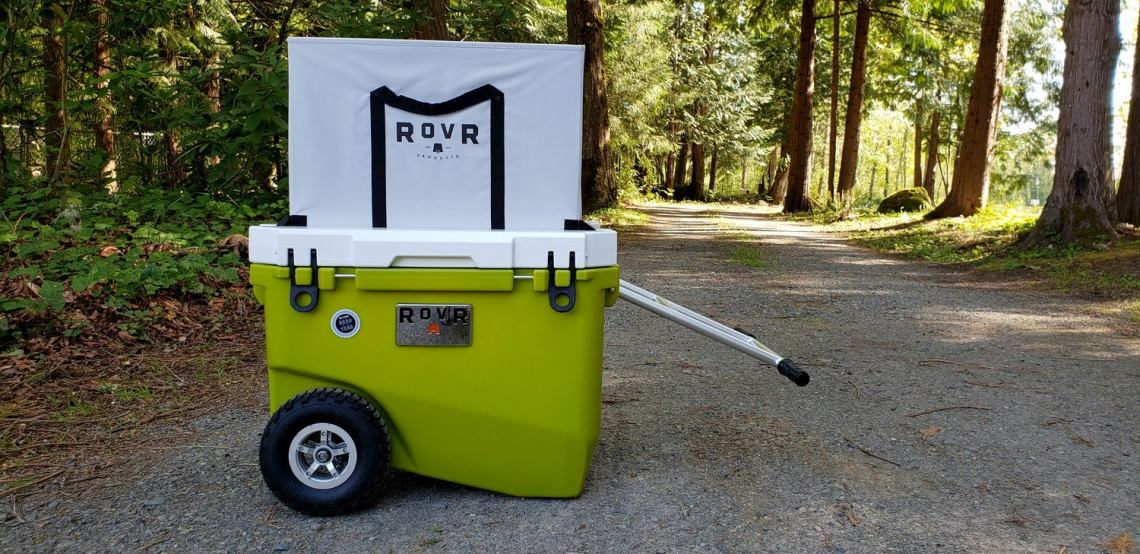 green Rovr cooler on a gravel road.