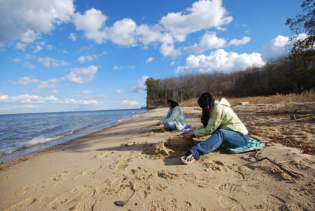 two women on the beach fossil hunting at westmoreland state park