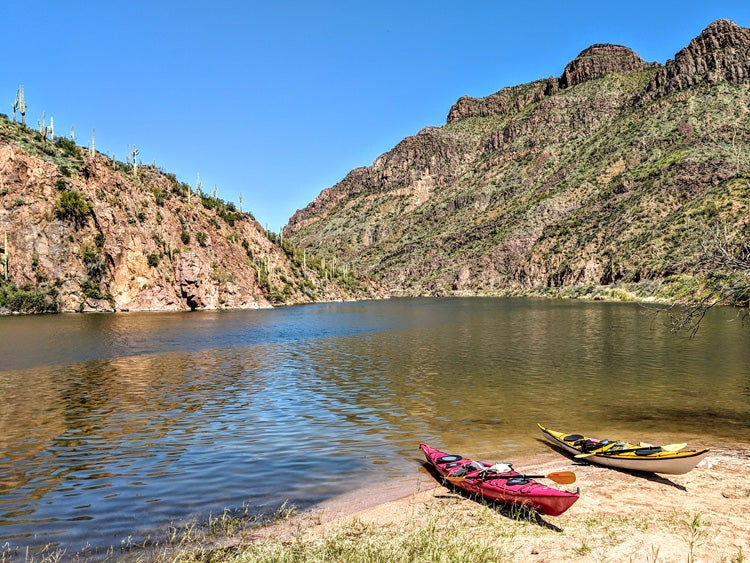 two kayaks on the shore of a lake in the superstition mountains