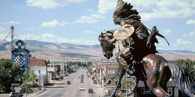 a downtown view of lander wyoming with a statue of a native american