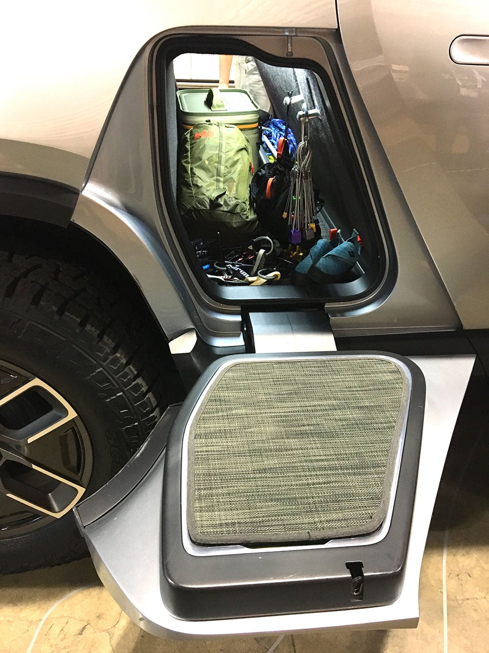Gear storage tunnel beneath backseats of the Rivian electric truck