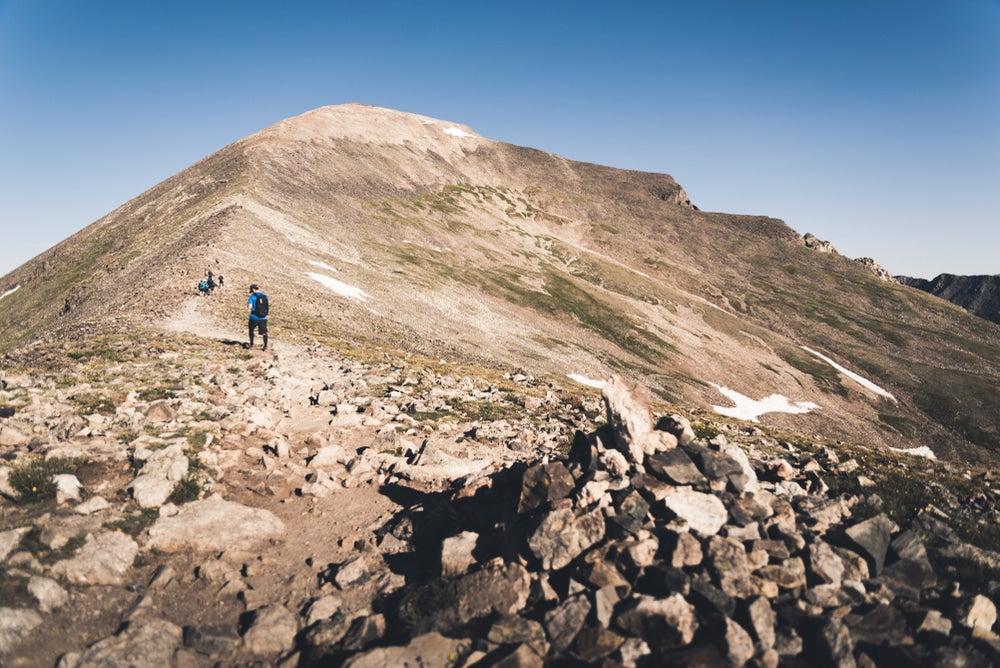 a man summiting TKTKTK