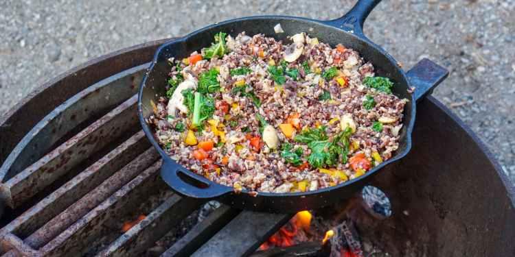 a cast iron pan full of vegetarian food