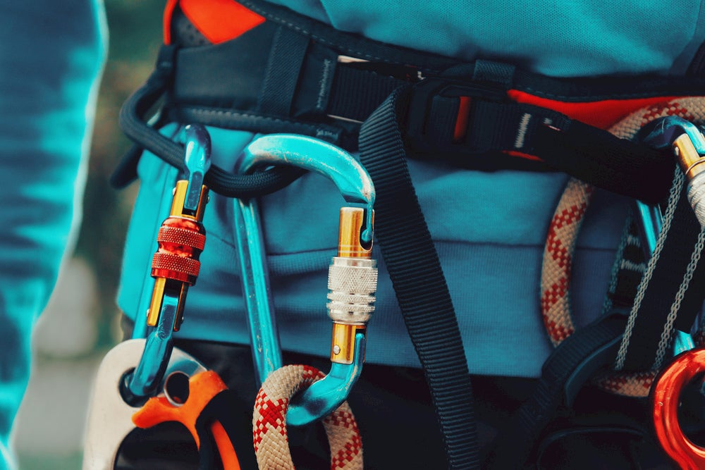 Locked carabiners on the harness of a climber.