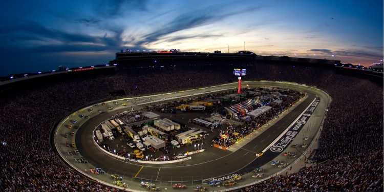 the bristol motor speedway at night during a nascar race