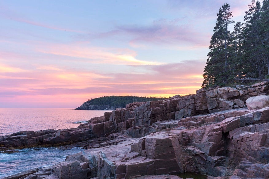 rocky shoreline colored blue and pink by the sunset near Blackwoods campground in Maine, photo from a camper on The Dyrt