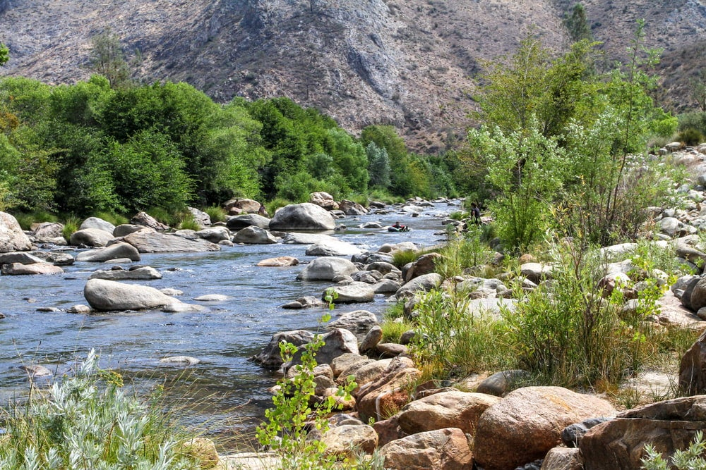 a man in a tube floating down the kern river
