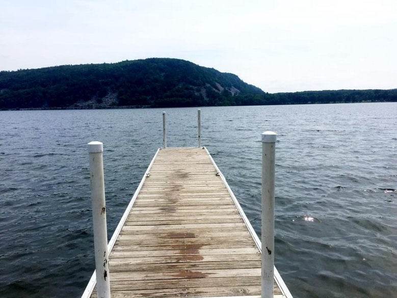 dock leading out to waters of Wisconsin's Devils Lake, photo from a camper on The Dyrt
