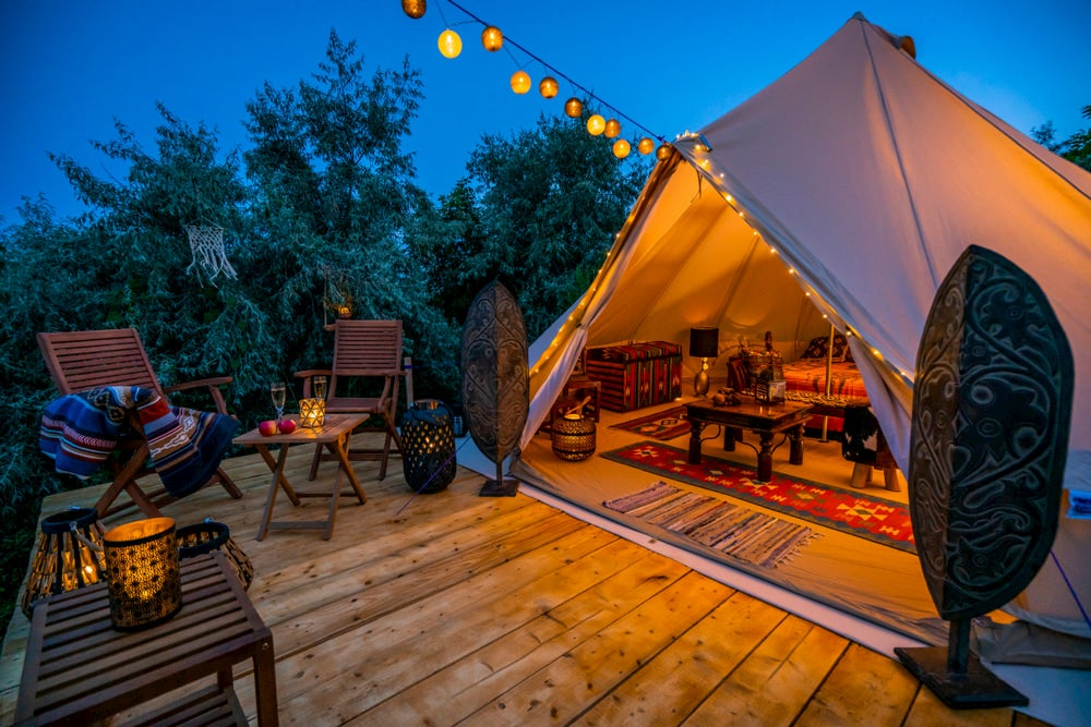 Tent with lights on wooden deck