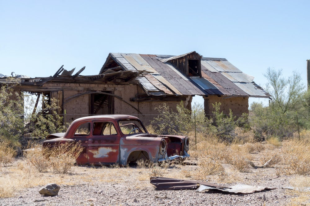 Old car and abandoned building in Vulture City, Arizona