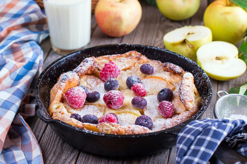 a dutch baby in a cast iron dutch oven breakfast meal