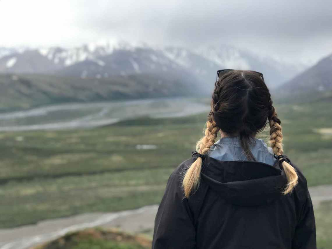 Female hiker in Denali backcountry wearing a black Red Ledge jacket.