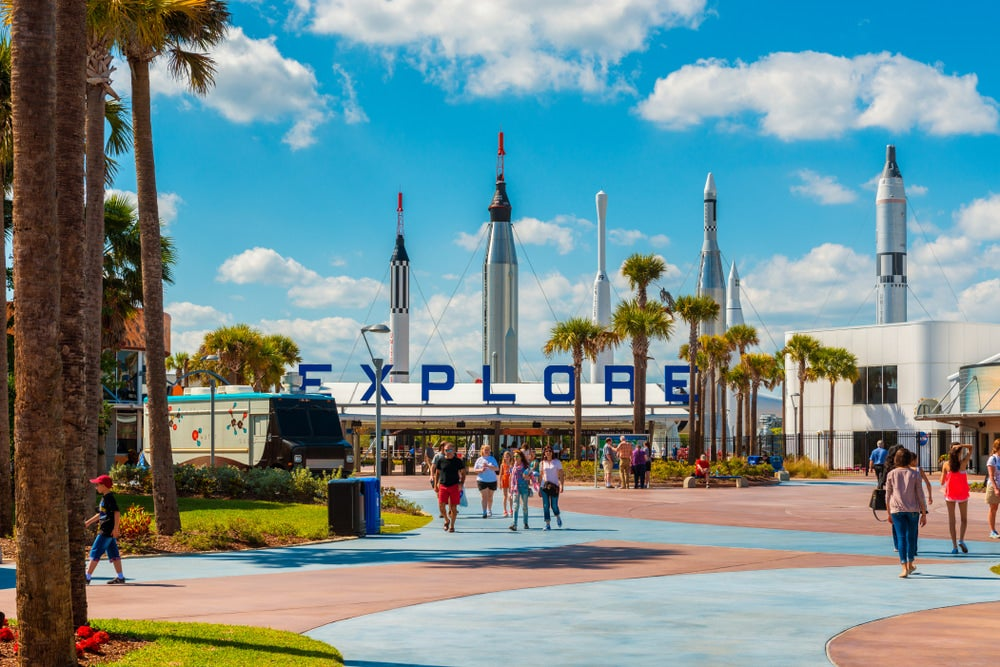 the kennedy space center in cape canaveral florida as people walk around space rockets