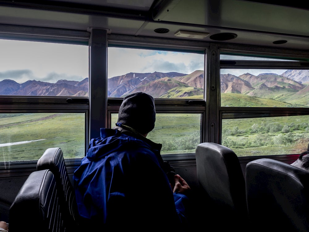 Visitor riding the Denali bus into the park.