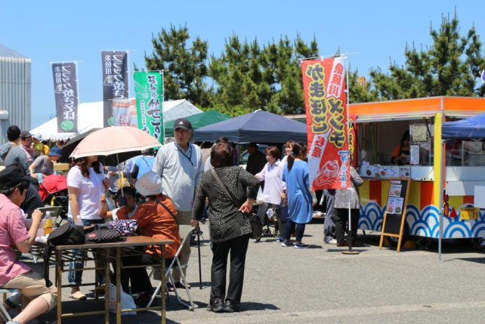 Visitors enjoy festival food from trucks and stalls