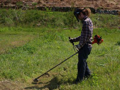 Me cutting grass - Photo by Masa Morimoto.