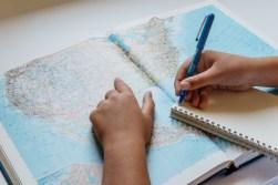 student studying atlas
