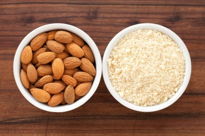 Two bowls. One with almonds. One with almond flour