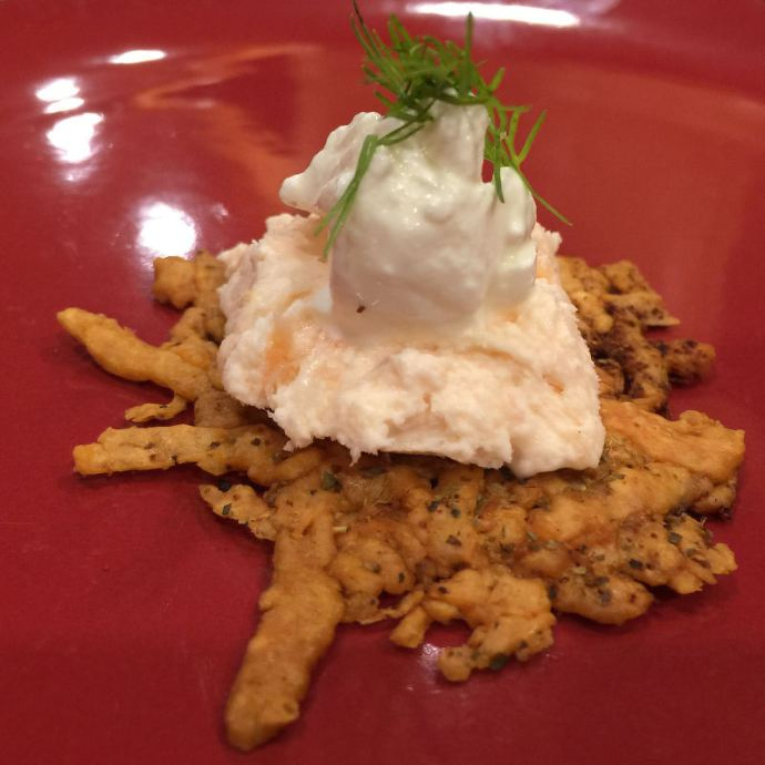 Smoked Salmon pâté with sour cream and dill on a cheese crisp