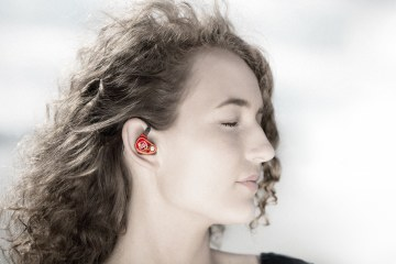 woman wearing 64 Audio in-ear monitors with eyes closed