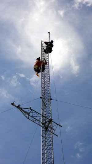 Lowering the top tower section