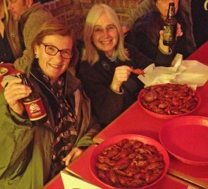 Lori and Marta enjoy a bottle of Abita as they dig into some boiled crawfish.