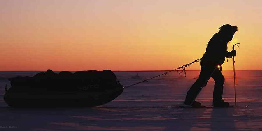 Polar explorer Ben Saunders pulls sled on the ice