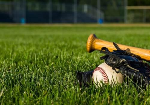 Baseball bat and ball on field