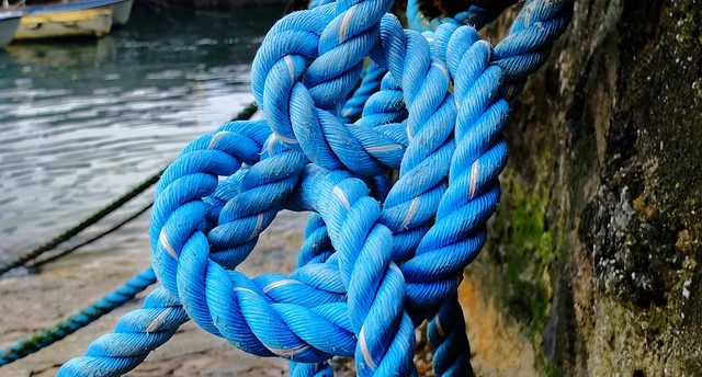 Boating rope knot representing re-anchoring for the annual budget.
