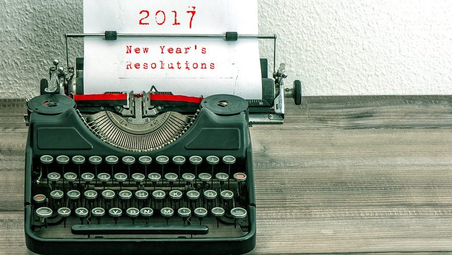 Typewriter with white paper page on wooden table. sample text 2017 New Year's Resolutions. vintage style toned picture--for finance and FP&A, forecasts