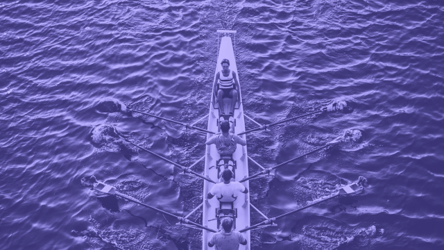 Team sailing on a river