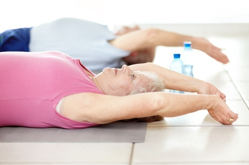OlderWomanStretching_canstockphoto4003334