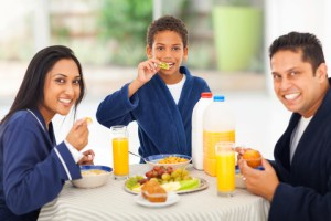 http://www.dreamstime.com/stock-photography-indian-family-breakfast-cheerful-cute-enjoying-their-together-image31624692