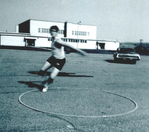 Discus Boy Mike Ziants practicing hurling that thing, after school, 1970