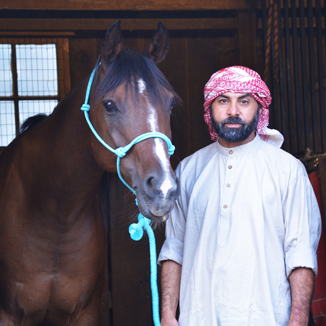Ahmed & Arabian Horse Waleed Standing Together
