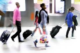 Persons walking through an airport