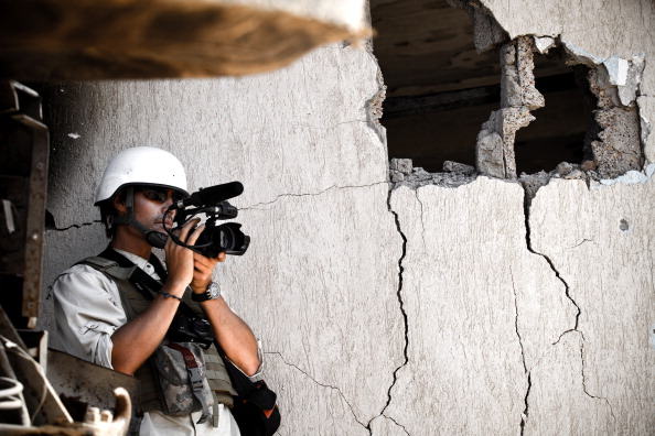 News organizations have pulled back their reporters, and those that remain are being more cautious in their travels. But the consequences are significant (Photo Credit: John Cantlie/Getty Images).
