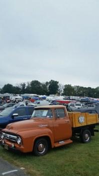 ford f100 custom orange pickup - Carlisle Car Show