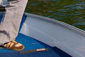 Testing boat floor for rot.