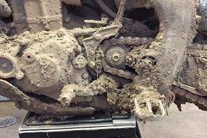 Muddy dirt bike chain.