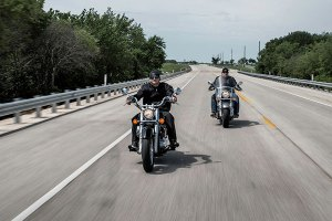 Motorcycles riding down the highway.