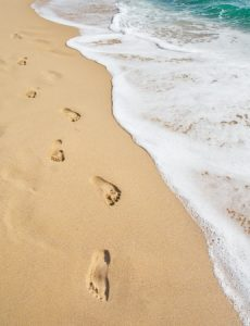 11984019 - beach, wave and footsteps