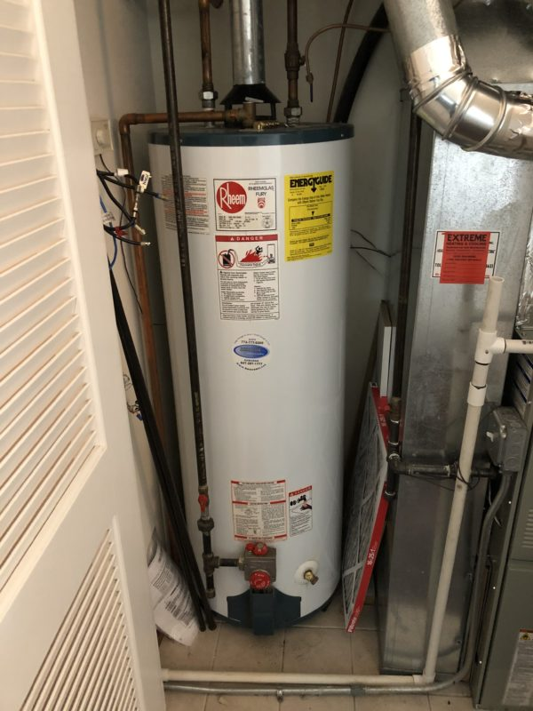 Installing Rheem Water Tank & American Standard Furnace Replacement in Chicago
