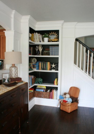 A built-in corner bookshelf.