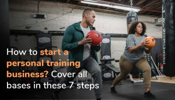 Personal trainer giving medicine ball lessons