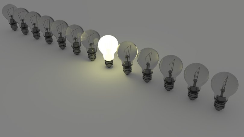 One glowing bulb showcasing standing out among others