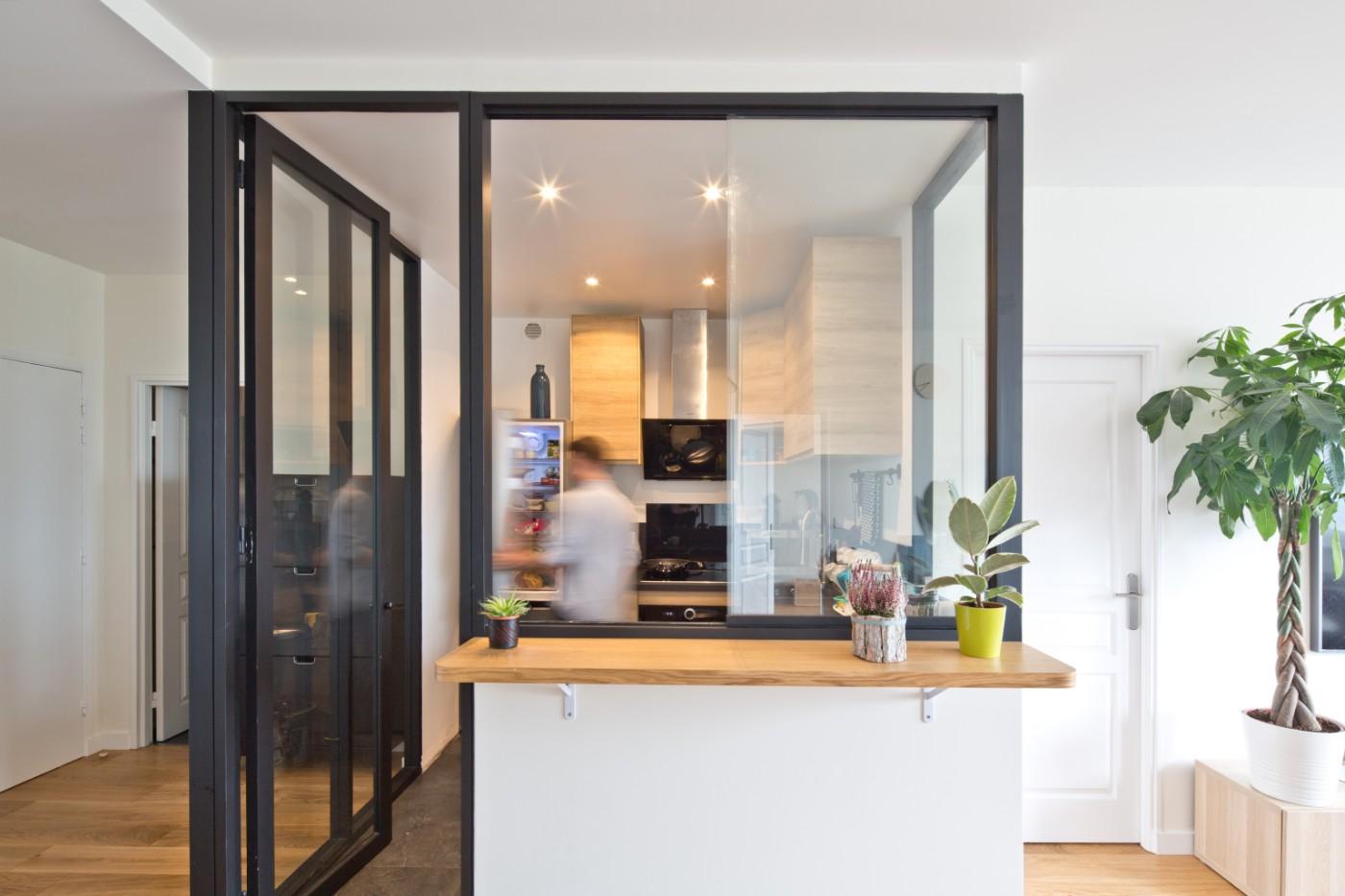 Cuisine ouverte et design par Archibien - rénovation d'un appartement à Courbevoie
