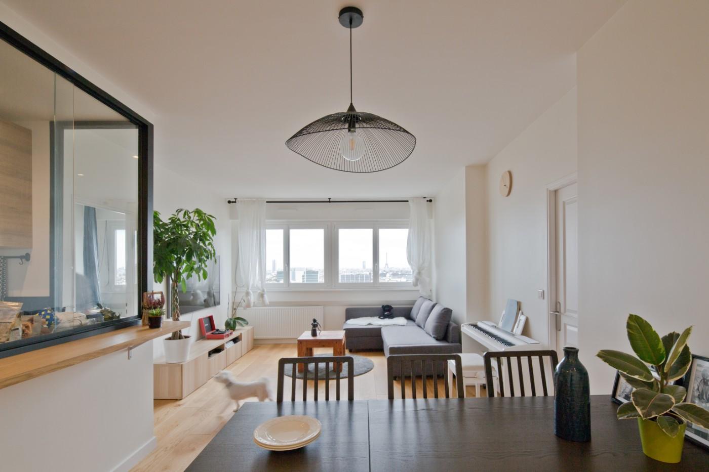 Salon de l'appartement à Courbevoie par Archibien